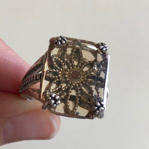 Amber colored ring with flower design. Size 8